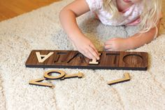 handmade childrens wooden name puzzle