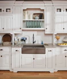 ... Inset Doors Are Accented With A Savory Mix Of Cabinet Latches, Bin  Pulls And Charming #beadboard Details. White #cabinets From Dura Supreme # Cabinetry.
