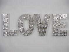 wooden letters - covered in coins or glass beads