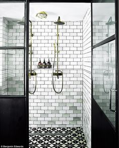 In the walk-in shower, steel cubicle doors with wire-mesh glass, metro brick tiles grouted in black for definition and monochrome floor tiles create a strong utilitarian effect. Decorative pattern adds a touch of luxury and softens the austere style