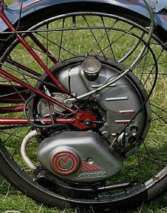 CycleMaster bike motor like I once had, it's wheel replaced the bikes rear wheel and had a clutch and throttle cable I could do about 50 mph on it as a teenager.