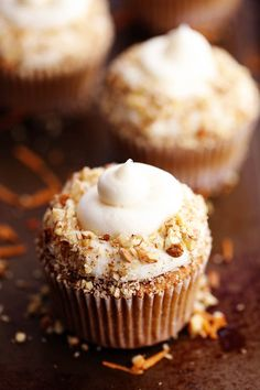 Carrot Cake Cupcakes with White Chocolate Cream Cheese Frosting - The most perfect and moist spiced carrot cake cupcakes with a white chocolate cream cheese frosting! These became one of my favorite cupcakes with the first bite! I am majorly obsessed with carrot cake.  It is easily one of my favorites. If you can hi