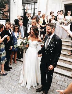 Off the shoulders wedding dress.