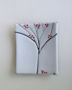 fused glass sushi plate with tree design.