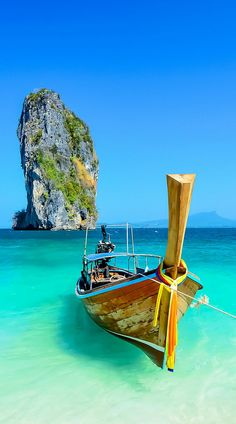 Cliff and boat in Krabi, Phuket, Thailand. We've got the perfect dress to compliment this destination  |  ≼❃≽  @kimludcom