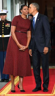 Barack Obama snuck in a last kiss at the White House before leaving the office at the end of his presidency on January 20, 2017. For her final first lady look, Michelle wore a burgundy short-sleeved, a-line silhouette dress by Jason Wu with black heels.