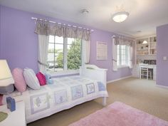 Purple girl's bedroom with built-in desk and lots of room to play. -- 9169 Victoria Drive Eden Prairie, MN 55347