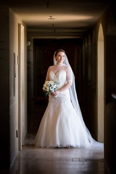 Moody and dramatic wedding San Diego bridal portraits. Lace wedding gown with sleeves