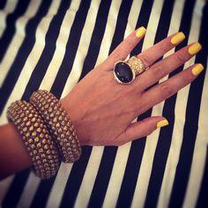 Yellow nails, YSL arty ring, chunky bangles