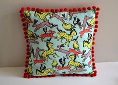 Guest post from Sarah of BlueSusan Makes: the pom-pom pillow!
