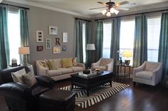 great possibility for the upstairs family room since the furniture is so similar and Love the grey walls