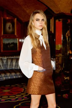 Cara Delevingne stuns in the new Topshop Christmas campaign. Go behind-the-scenes in a sneak peek video here: