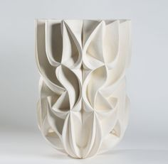 Strong geometric elements combined with recurrent patterns and architectural principles to give way to this beautiful hand-carved ceramic. Unglazed white stoneware by Halima Cassell.