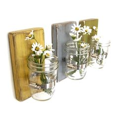 DIY wall decor with mason jars and wood.  Im going to put two of these on every fence panel and put candles in them.  It will beautiful for an evening dinner/party in the garden!