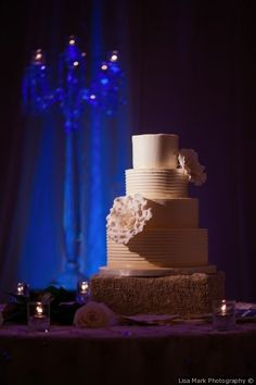 Classic wedding cake idea - four-tier, buttercream-frosted #weddingcake with sugar flowers {Lisa Mark Photography}