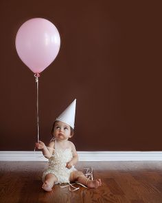 Cute 1st birthday picture. Claire1 by farrahj, via Flickr.