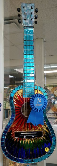 FIRST PLACE - MOSAICS CATEGORY. Mirror Mosaic Guitar (side 1). Artist: Andrea Spaulding. Just For Fun Contest. Stained Glass Express. Manchester, Maine.
