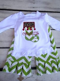 Girl's Christmas outfit with ruffle pants, chevron and personalized, leopard, green chevron, whimsical, stocking applique. $42.00, via Etsy.