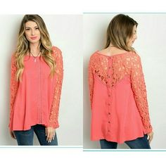 Beautiful lace detail top FINAL REDUCTION Coral color. Lace sleeves and top of back. button details down back of shirt. 100% rayon. Price is firm. Retail items can only be bundled with other retail items. Sassy Lea to a T Tops Blouses