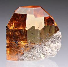 Topaz. I like  gold, pink and blue topaz. My gem stone.