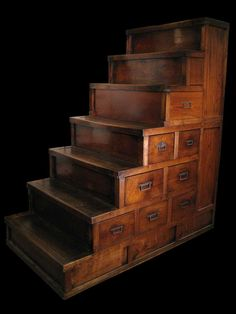 """Make this out of card catalogues and wood crates. In a smaller scale would be good """"pet steps"""" for easy bed access...+ storage!"""