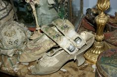 One of Marie Antoinette's shoes, originally lost when the Queen and royal family fled the Tuileries when it was stormed in 1792, along with embroidered garters once belonging to Marie, and embroidered bonnet once belonging to her daughter, Marie Therese.