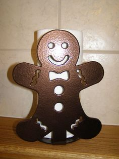 Gingerbread Man Paper Towel Holder. $45.00, via Etsy.
