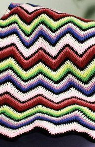Add a pop of color to your home decor with this beautiful Rainbow Ripple Afghan. This is an easy crochet afghan pattern to complete using a variety of different colored worsted weight yarn. Red Heart Super Saver is a great choice for this free pattern. It measures approximately 45 inches by 60 inches when complete, which is just the right size for curling up with on the couch.