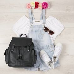 Glastonbury Festival Day Four: White off the shoulder top, light washed denim short dungarees, floral festival headband, white trainers, PU snakeskin backpack and tortoiseshell sunglasses.
