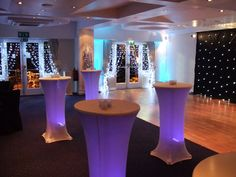 St George's Hill LTC Surrey - Starcloth backdrop, wall uplighters in ice blue, cool white pealight curtains, silver twisted willow with cool white pealights and illuminated poseur tables by www.stressfreehire.com #venuetransformers