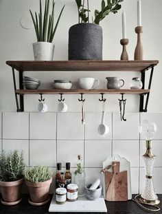 grey, white, green, dark blonde woods, industrial details and textured glass and natural materials