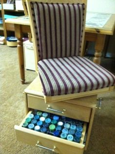 A husband made this to carry paints in an RV. He cut off the chair legs and mounted it on a swivel-topped box, with 3 drawers sized to hold commercial wire paint bottle racks. Wheels on the bottom make it easy to move (it can get heavy), and a handle on the side lets you move the whole thing. Takes up no more room than the chair did, holds dozens of paints, all sorted.