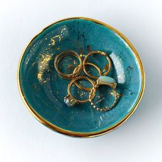 Jewelry Dish in Teal and gold, Teal Splatter Dish  This little gem is glazed in teal and accented in 22k gold.  Use this petite hand carved bowl around your home - • for sides & spices • to hold your special rings, cufflinks, or earrings • to keep your daily vitamins • if youre into sushi, theyre great for soy sauce, wasabi, or ginger • Approx 3.5 wide   To add a monogram, follow this link: https://www.etsy.com/listing/264745340/teal-and-gold-monogrammed-jewelry-dish?ref=shop_home_listings…