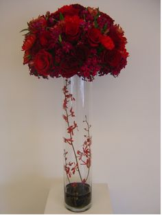 baby's breath in my cylinder vases with a burst of red on top.  red glass beads on the bottom.  hmm.