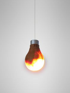 """Osaka-born designer Ryosuke Fukusada's Wooden Light Bulb prototype.   """"The traditional craft technique is the real value behind the bulb. More than just a lamp, the bulb means to preserve cultural heritage and man's timeless link to his true roots, nature. It was wood that gave light and heat to the oldest of civilizations. This lovely illuminant contrivance is perhaps symbolic of that golden age."""""""