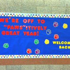 """HOPES AND DREAMS BULLETIN BOARD. At the end of the year... """"We deserve a round of a-paws for our hard work"""" with 2 paws per student, to see if they reached their goal for the year."""