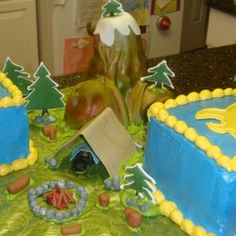 http://www.cakecentral.com/gallery/i/1589358/cub-scout-boy-scout-crossover-cake