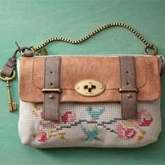 Perforated Mason bags make the perfect canvas for creating cross-stitch designs. (via Fossil Blog)