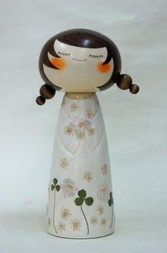 Kokeshi name: Plays with a flower Artist: Mr. Hiroyuki Okamoto 2011