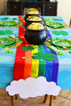 Celebrate St. Patrick's Day St. with a colorful party like this one! Love the rainbow table runner!! See more party ideas and share yours at CatchMyParty.com #catchmyparty #stpatricksdayparty #rainbowparty