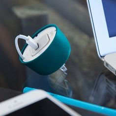 PowerCurl Mini - If you prefer to charge from the mains, this space-saving solution helps keep US-style Apple 5W USB power adapters neat and tidy. | via TNW
