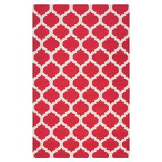 Handcrafted flatweave wool rug with a red quatrefoil motif.  Product: RugConstruction Material: 100% Wool