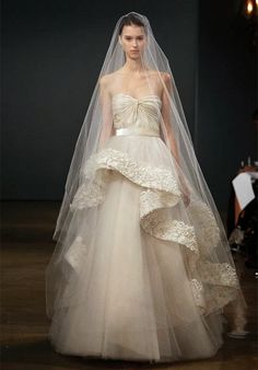 Gorgeous and dramatic. This wide border veil with a blusher is suited to formal cathedral or church weddings. Stunning bridal look. Just look at the detail in the wide bands of hand embroidered lace.