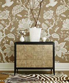 Schumacher Bali Vine is reproduced in this dramatic 54 iinch wide wallcovering. Table screen printed on a heavy and breathable paper, this exotic design features a grand vertical repeat of more than seven feet. F. Schumacher & Company Suite 110 in MDC