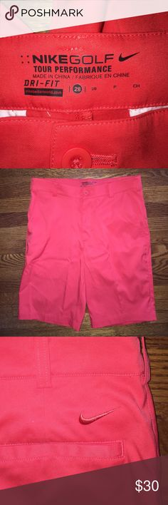 Nike DRI-FIT Flat front golf shorts...Size 28 Excellent condition Nike DRI-FIT Tour Performance flat front golf shorts...red...Size 28...no rips, stains or snags...from a smoke free home! Nike Shorts Flat Front