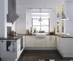 It's an IKEA brand click laminate floor... love the countertops and white cupboards... ikea cabinets - like the way the window is framed... Like the 'feel' and colors (wood/white) despite traditional... style, but a good example of every thing fitting together.