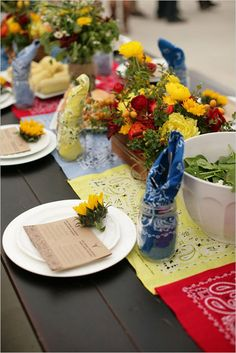 Mason jars filled with handkerchief for napkin. Love the handkerchiefs down the center of the table. Great Western theme party ideas!