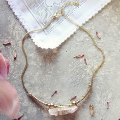 A gorgeous pink crystal is set in a soft gold setting. Drapes beautifully over the collarbone. The perfect necklace for any boho gal.   Color: Gold & pink crystal Length: 20""