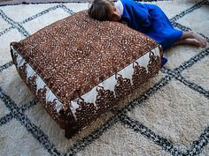 I would LOVE a big Moroccan pouf (and rug) just like this!
