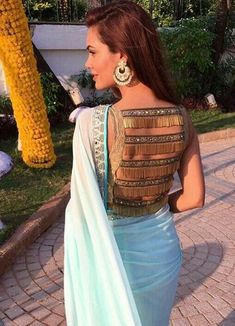 blouse designs Latest Saree Blouse Designs To Try. Ethnic and cultural wear such as sarees are a trademark of the subcontinent women. Be it embroideries, laces, ribbons, beads or gota; Choli Designs, New Saree Blouse Designs, Fancy Blouse Designs, Latest Blouse Designs, Golden Blouse Designs, Indian Blouse Designs, Blouse Patterns, Blouse Styles, Sari Bluse